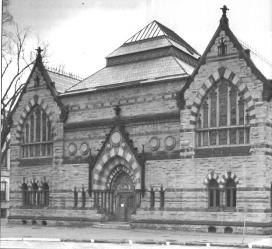 An early photo of the High Victorian Gothic building, pointed arches, twin gables, multi-color stone patterns,skylight, stained glass windows