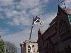 A restored skylight is returned to the roof in repairs undertaken in 2001