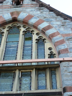 Stained glass window on west gable, showing steel tie placed in 1979 stabilization repairs