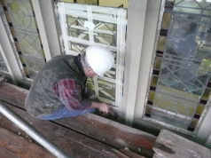 Removing the stained glass panels for repair