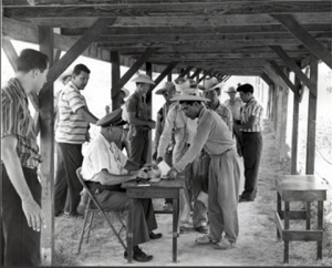 Braceros at processing center, 1957.  Photo, U.S. Citizenship and Immigration Service